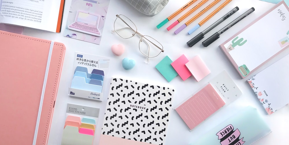 pink sticky notes on white paper
