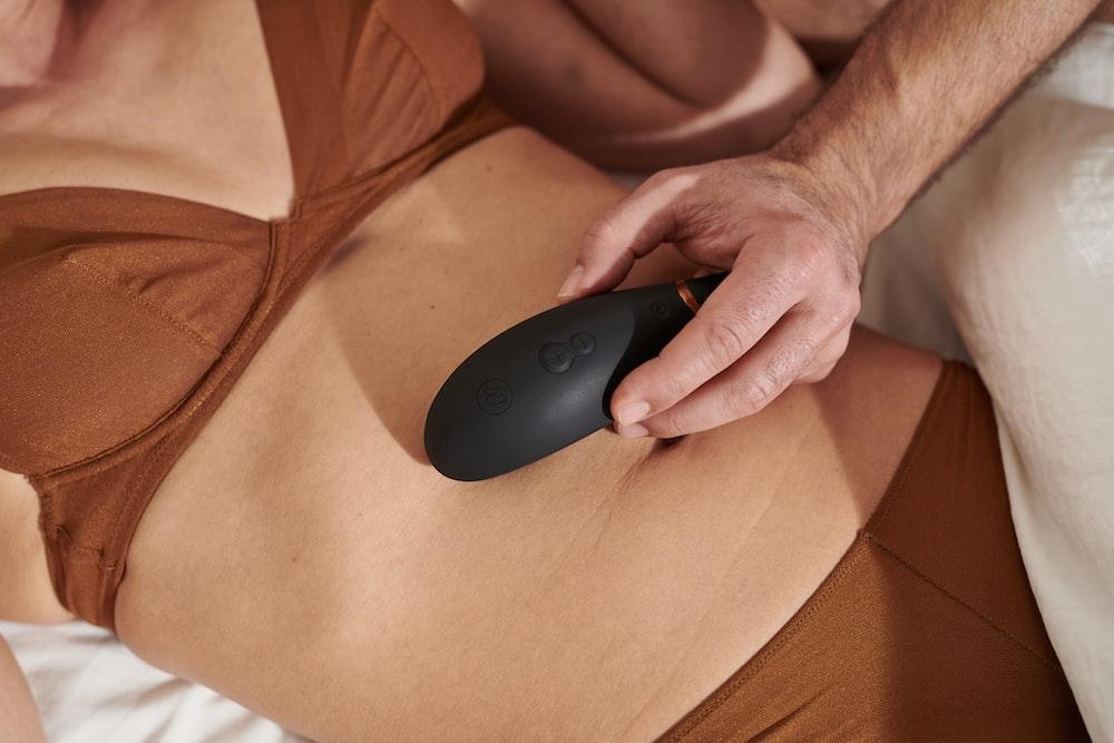 person holding black logitech cordless computer mouse