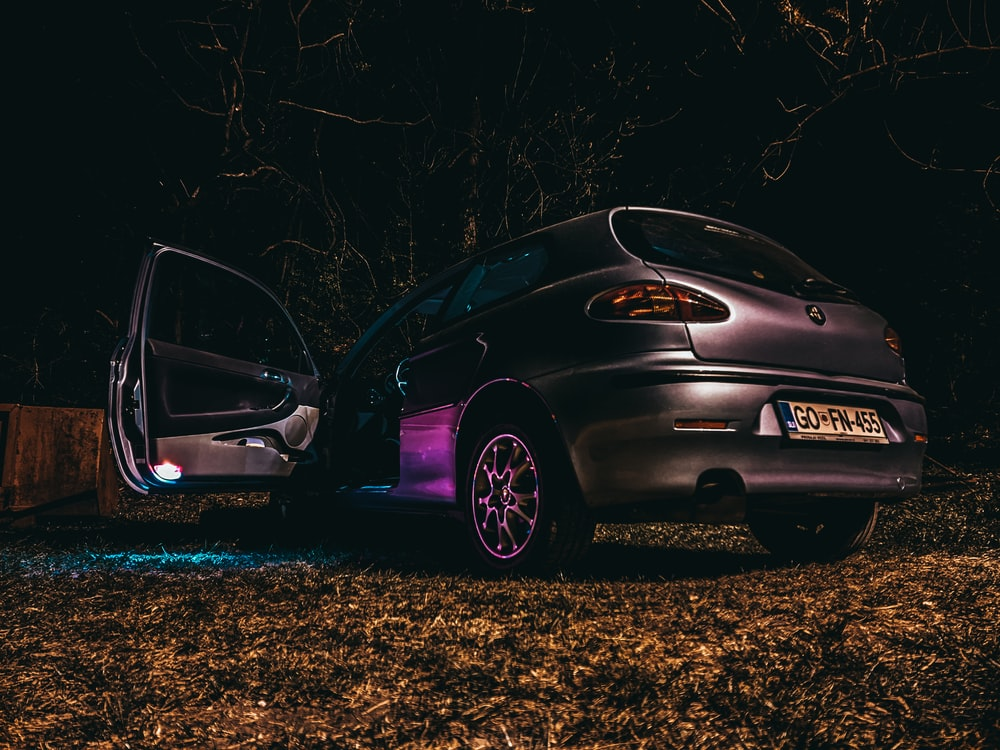 purple honda car on brown field during night time