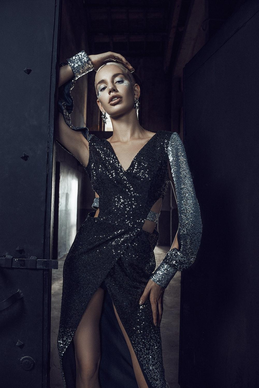 woman in blue long sleeve dress