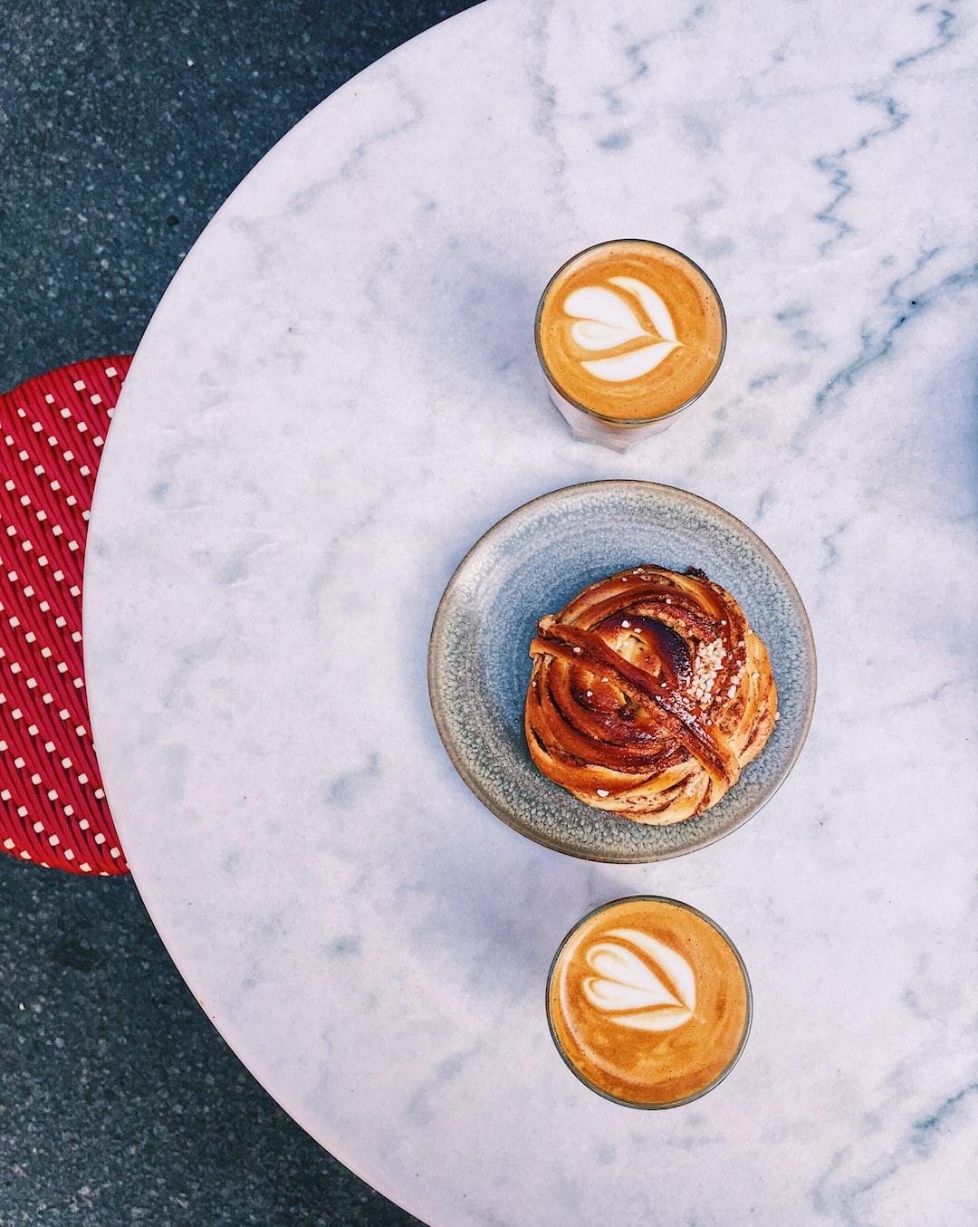 Fica time with cortado coffee and a cinnamon bun at Café & Bageri Pascal in Södermalm, Sotckholm. June 2019.