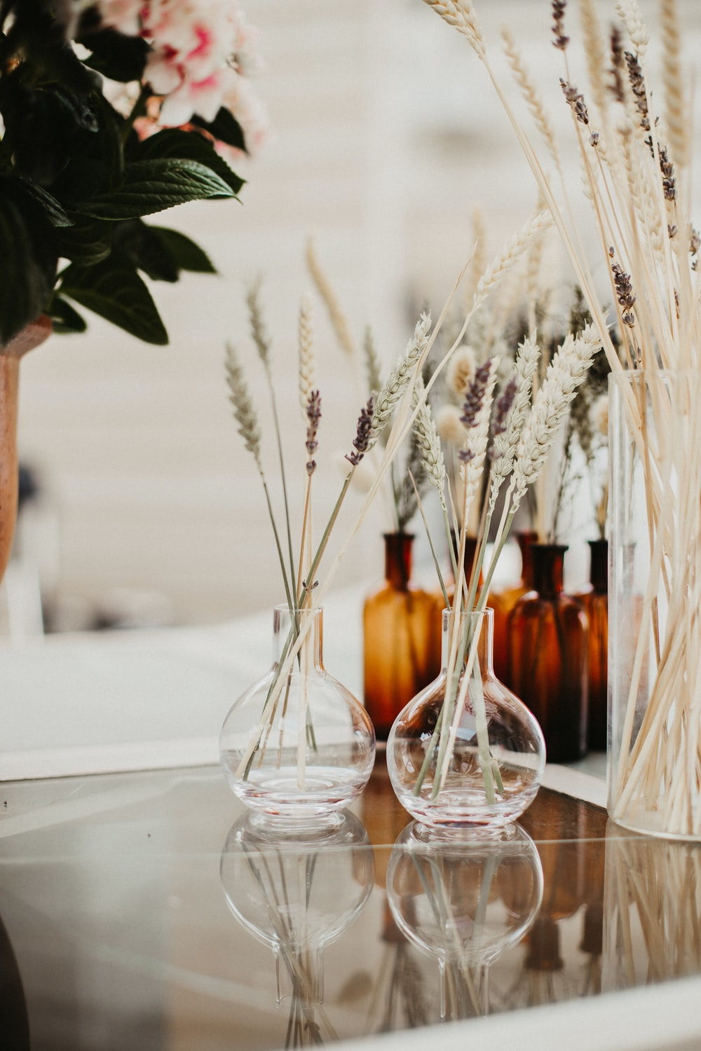clear glass bottles on white table