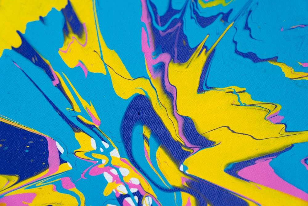 blue yellow and pink abstract painting