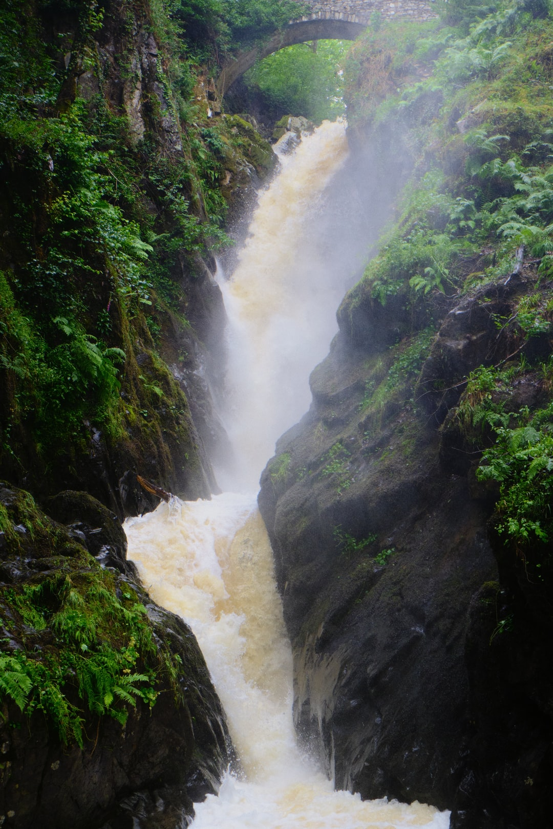 Aira Force, in full spate after a weekend of heavy rain. The waterfall is probably one of the Lake District's most famous, dropping 70ft in two parts with a picturesque packhorse bridge arching above it.