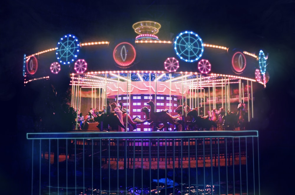 blue and white lighted carousel during night time