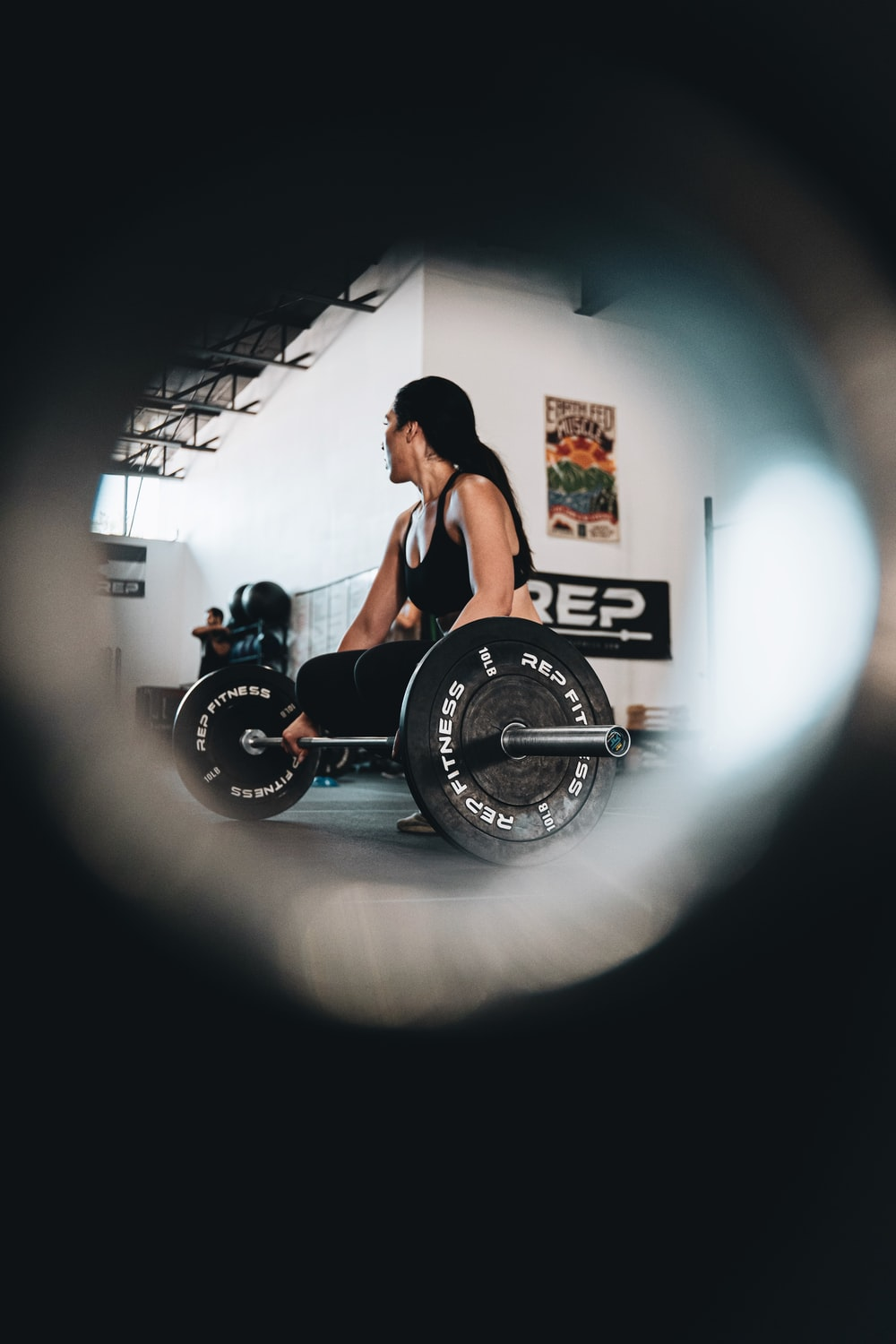 woman in black tank top sitting on black and white wheel chair