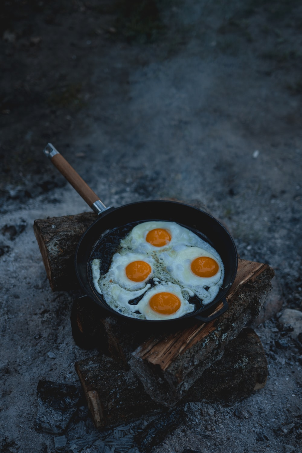 black frying pan with white cream and brown wooden stick