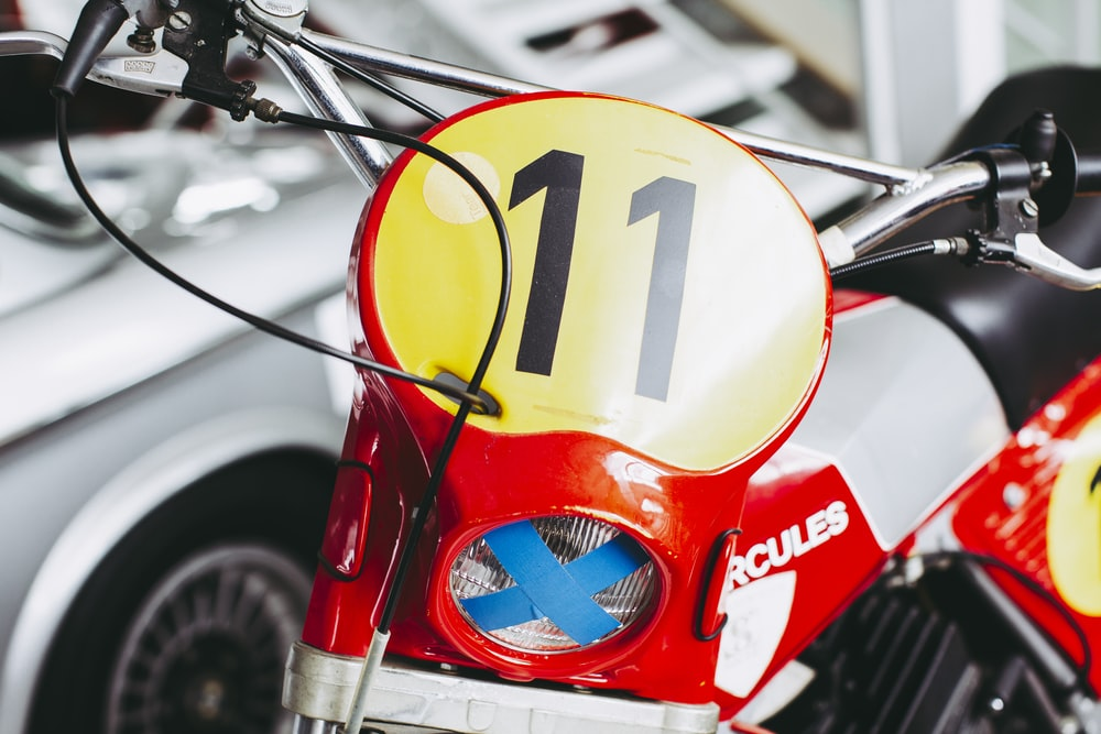 red and yellow motorcycle with black and white arrow sign