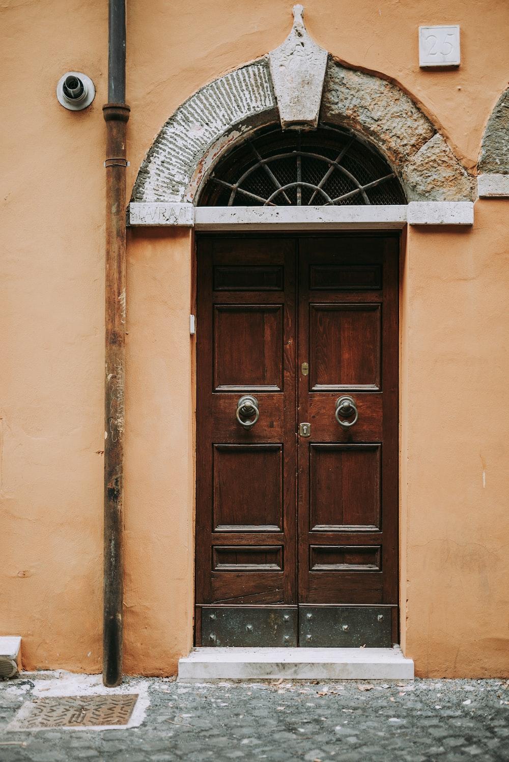 brown wooden door on beige concrete building