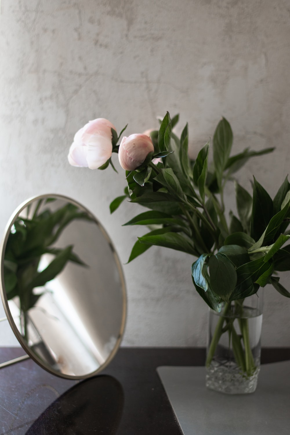 pink roses in green glass vase