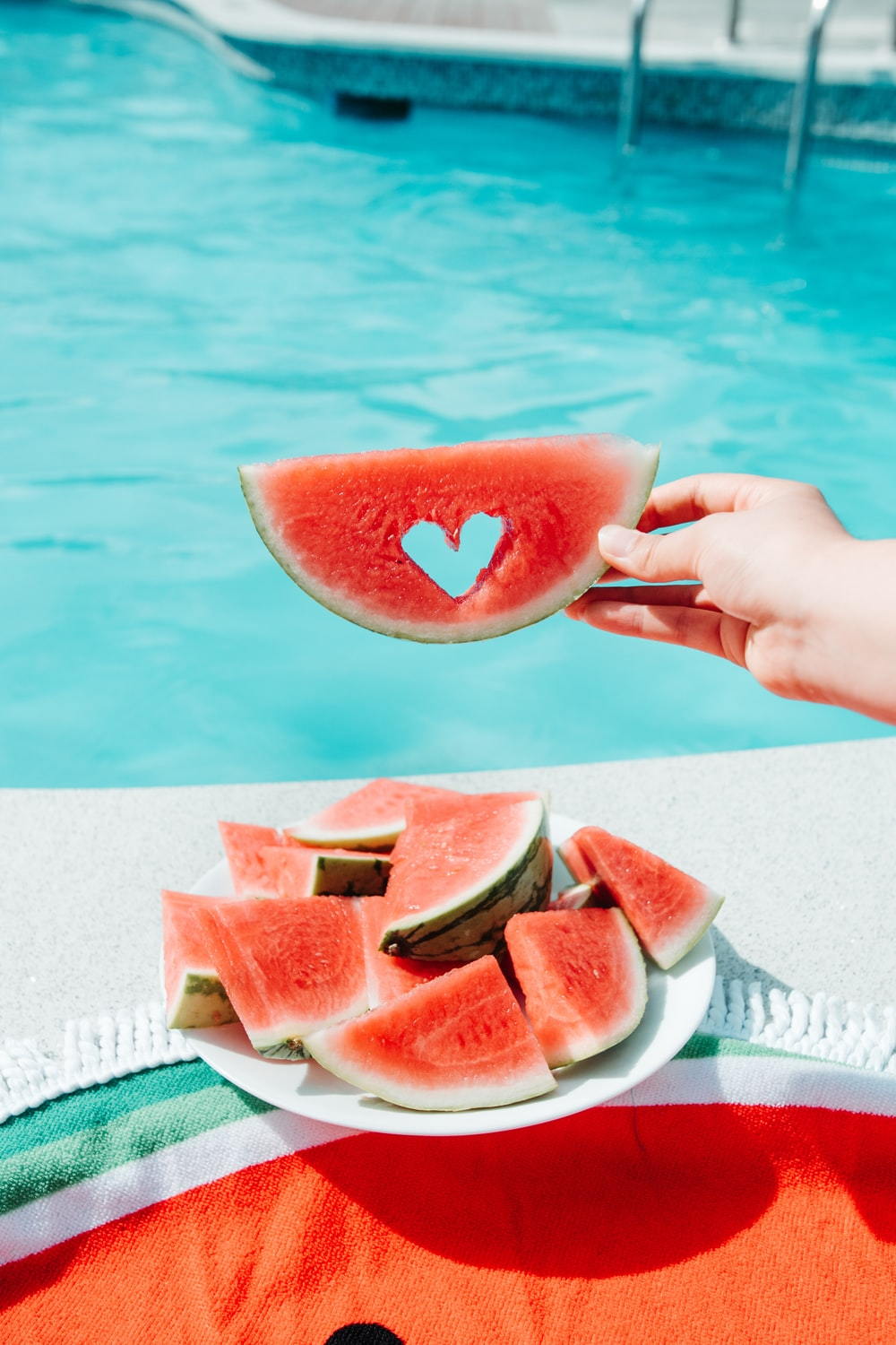 sliced watermelon on white paper