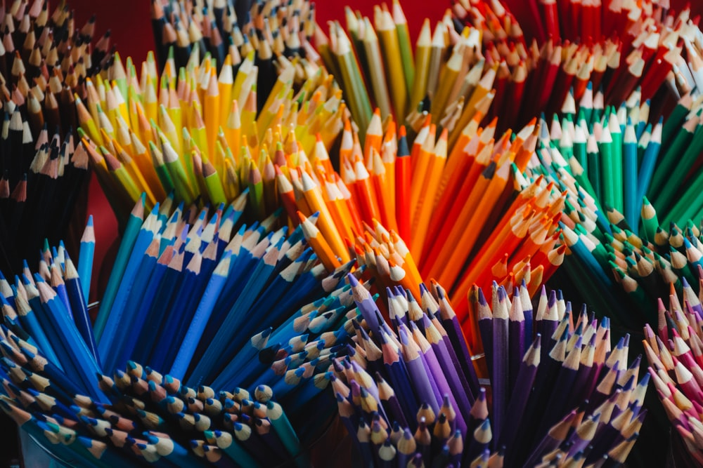 yellow blue red and purple coloring pencils