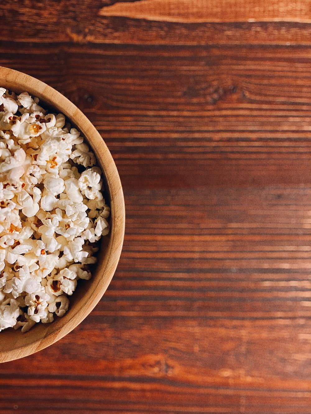 white popcorn on brown wooden bowl