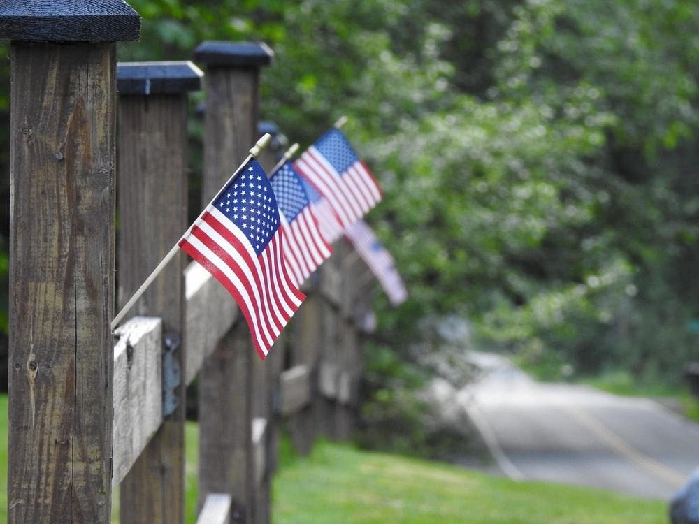 us a flag on wooden fence
