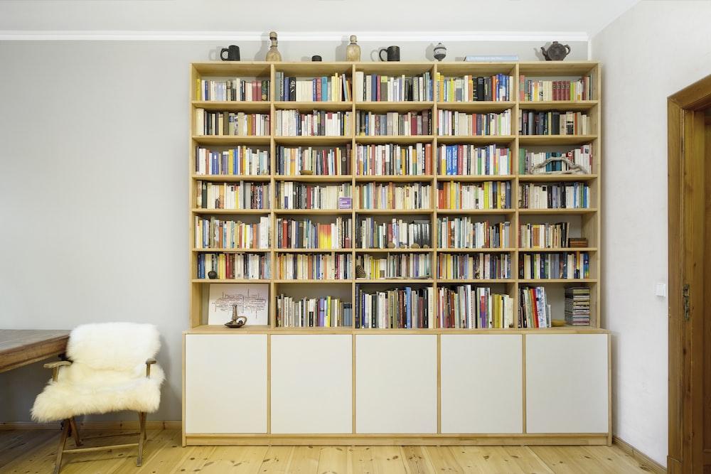 books on white wooden shelf