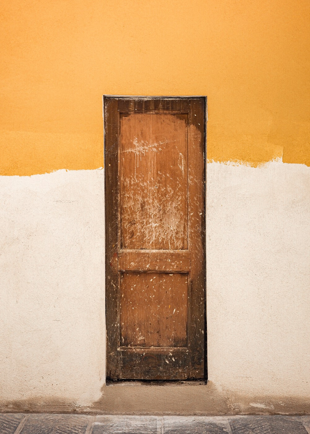 brown wooden door on white snow covered ground