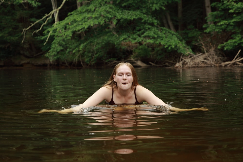 woman in body of water during daytime