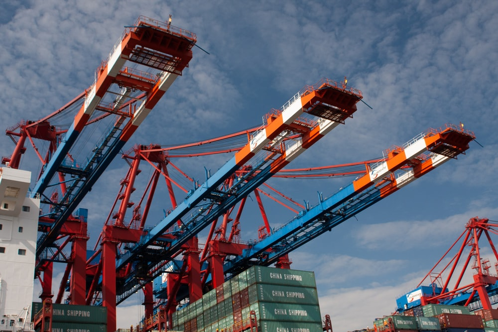 red and blue crane under blue sky during daytime