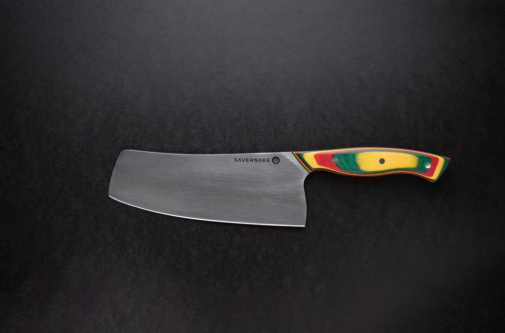 orange handle stainless steel knife