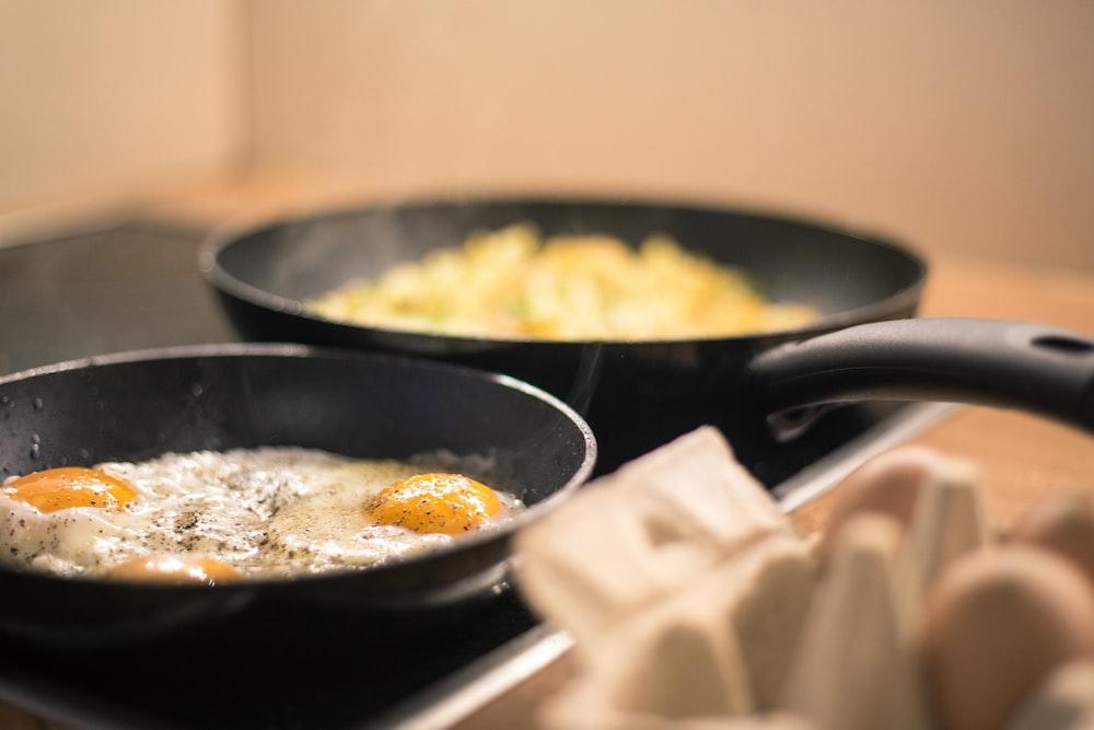 black ceramic bowl with yellow rice