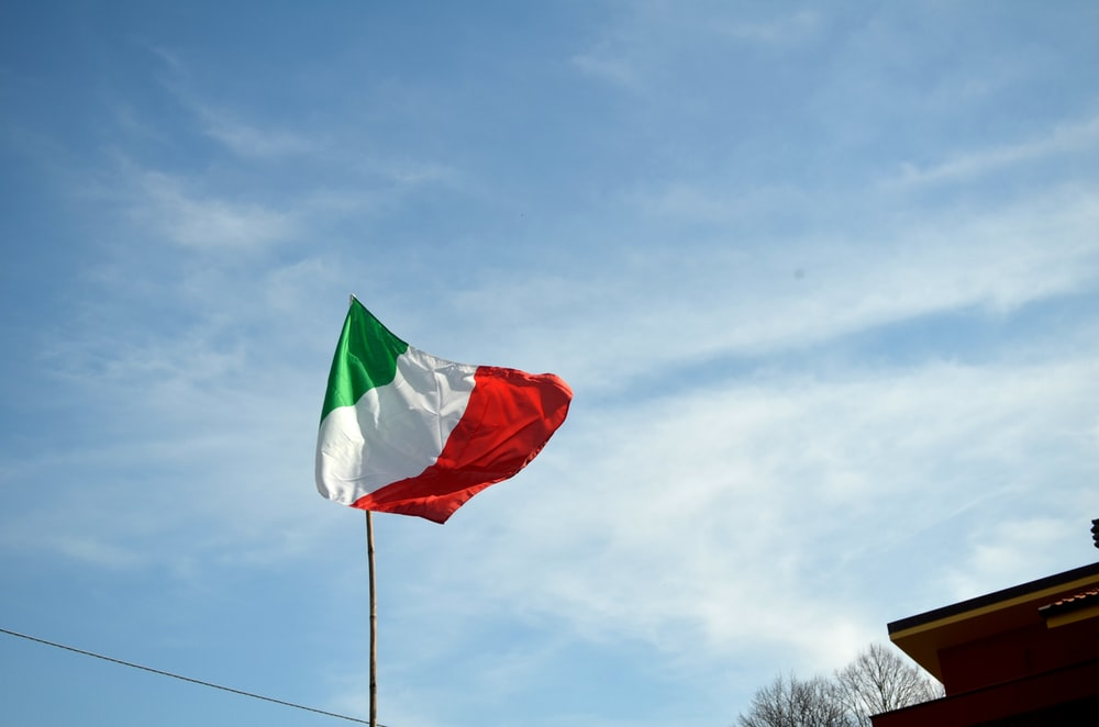 green and red flag under blue sky during daytime
