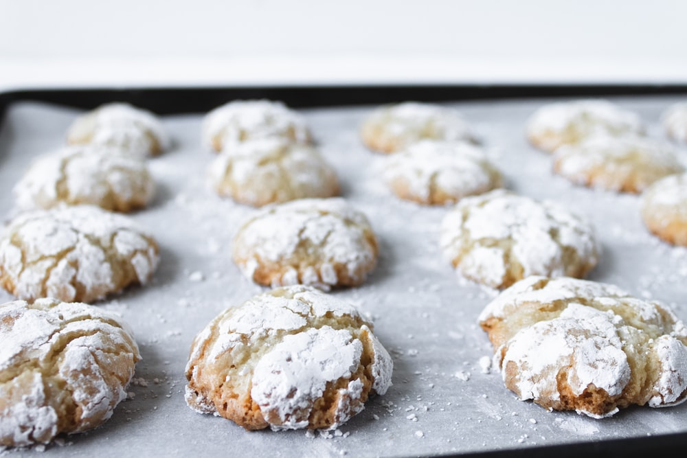 white and brown cookies on black tray