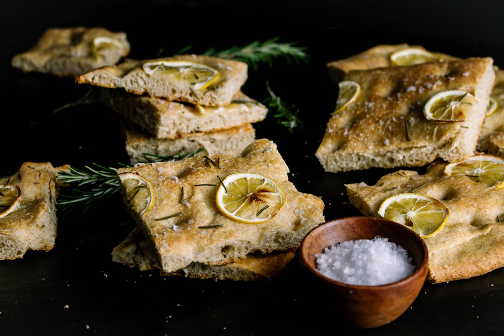 brown bread with sliced lemon on black surface