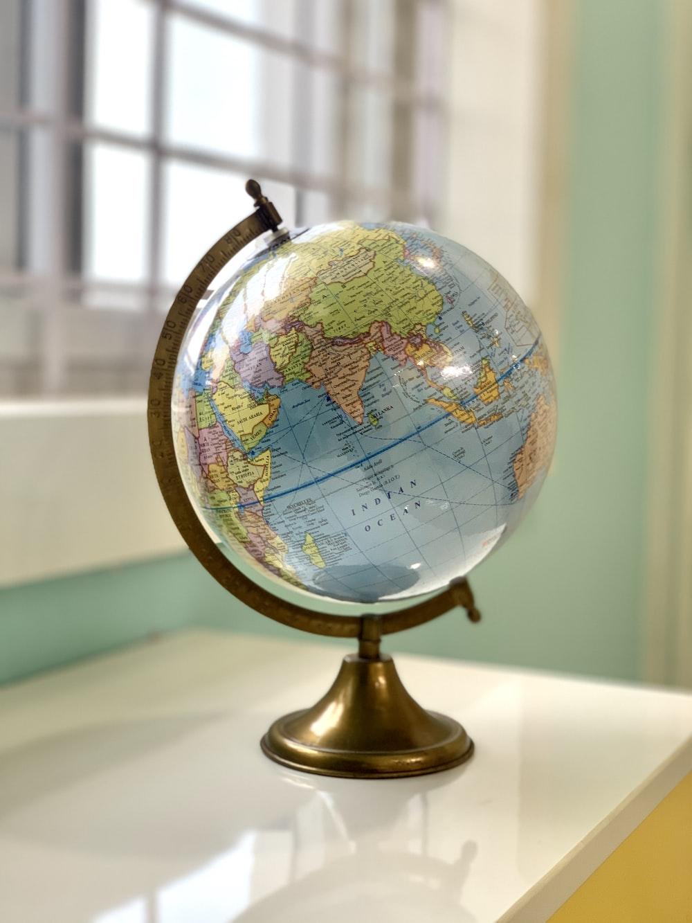 desk globe on white table