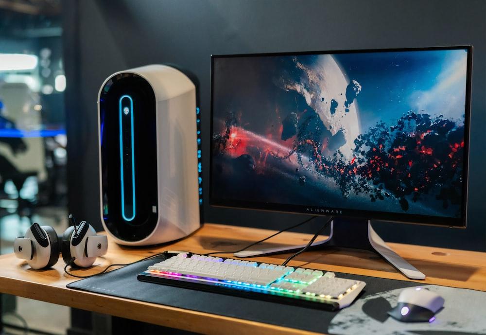 black flat screen computer monitor beside white computer keyboard