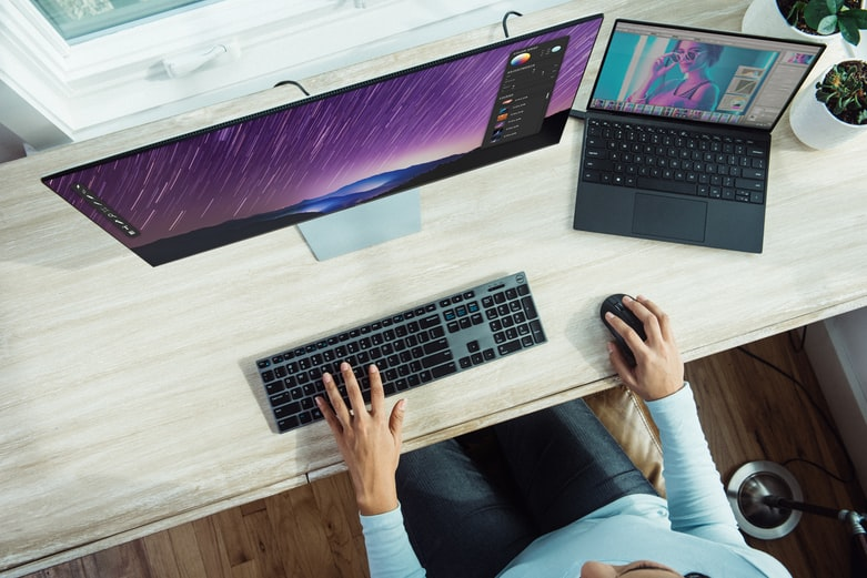 person using laptop on table