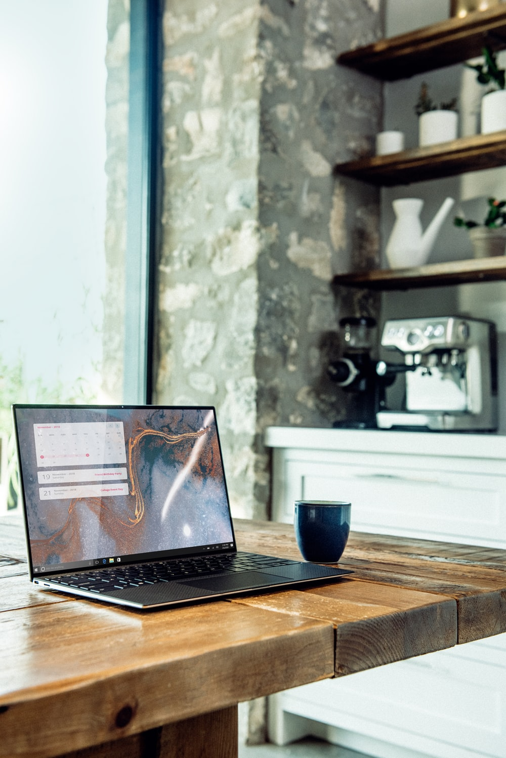 laptop on brown wooden table