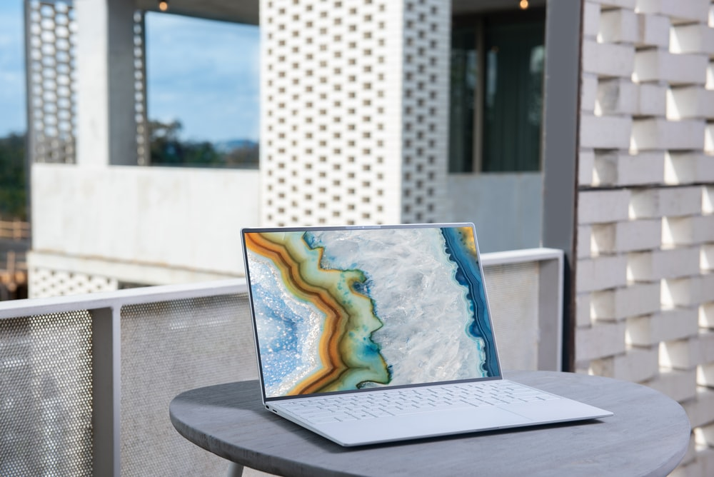 laptop on gray table