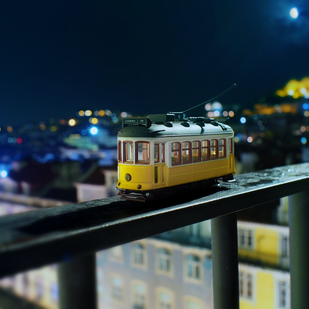 yellow train on rail during night time