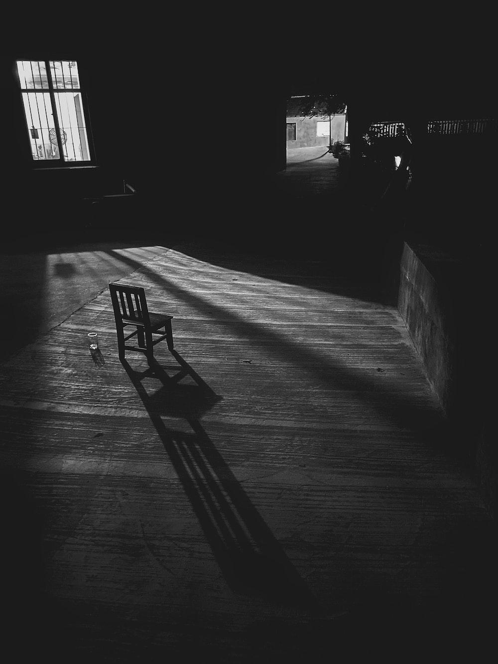black chair on gray concrete floor
