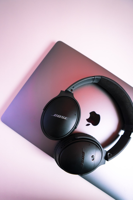black sony headphones on pink ipad case