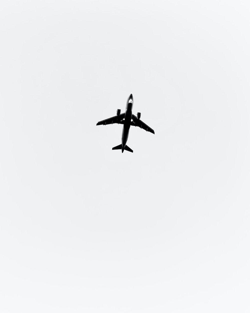 black airplane in mid air
