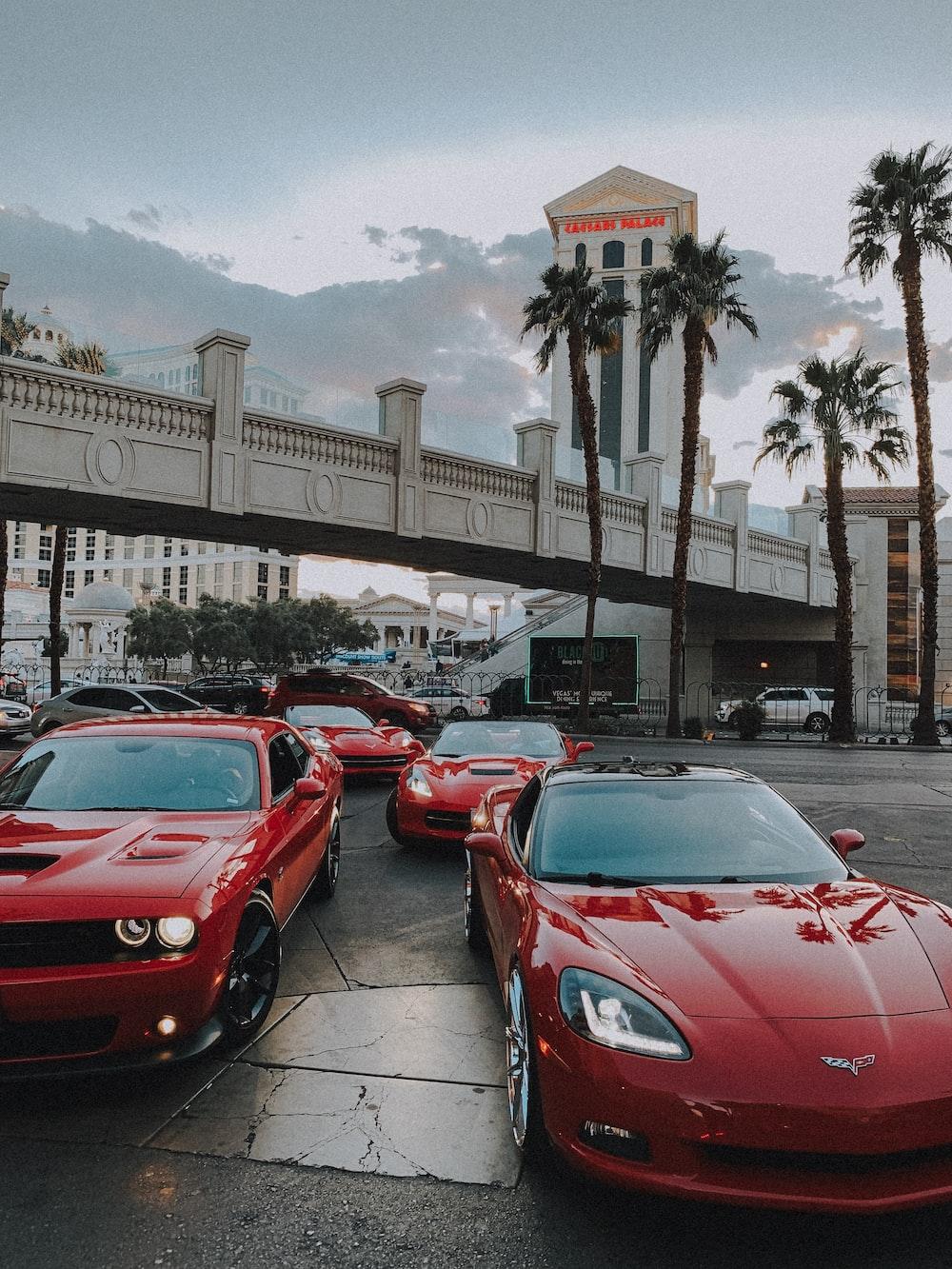 red ferrari 458 italia parked on sidewalk during daytime
