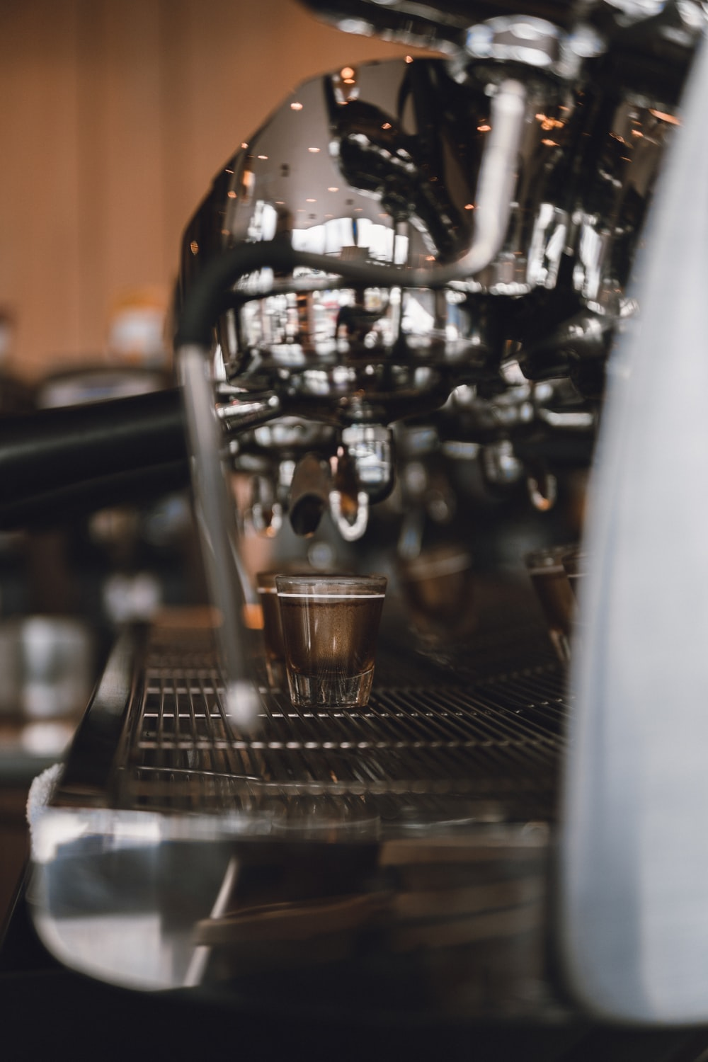 stainless steel espresso machine with clear drinking glass