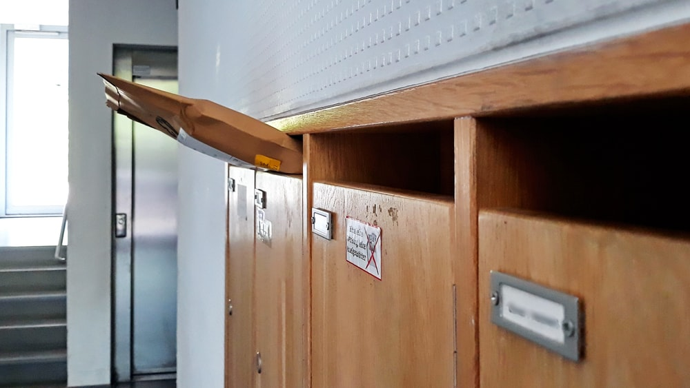 brown wooden cabinet near white window blinds