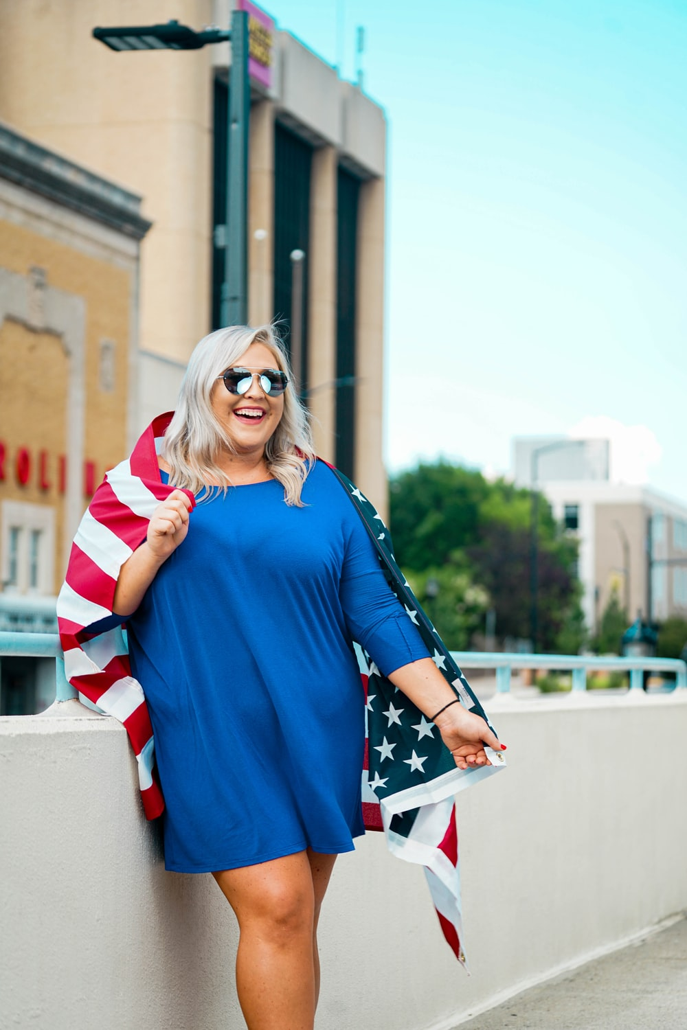 woman in blue white and red long sleeve dress