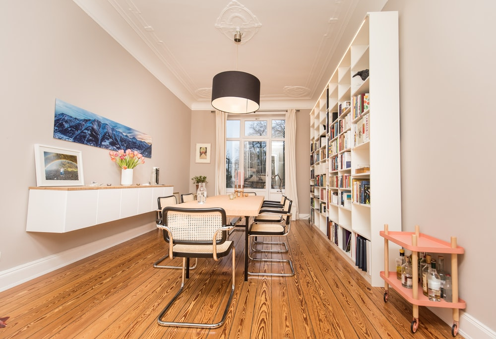 white and black chairs on brown wooden floor
