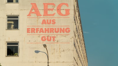 "Lettering on abandoned factory building ""AEG – Aus Erfahrung gut"" means: good by experience."
