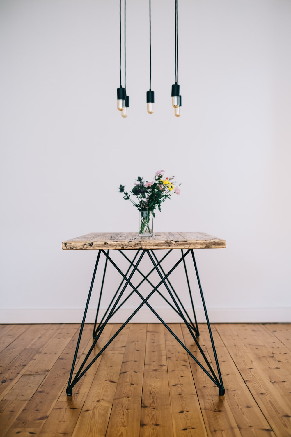 brown wooden folding table with flowers on top