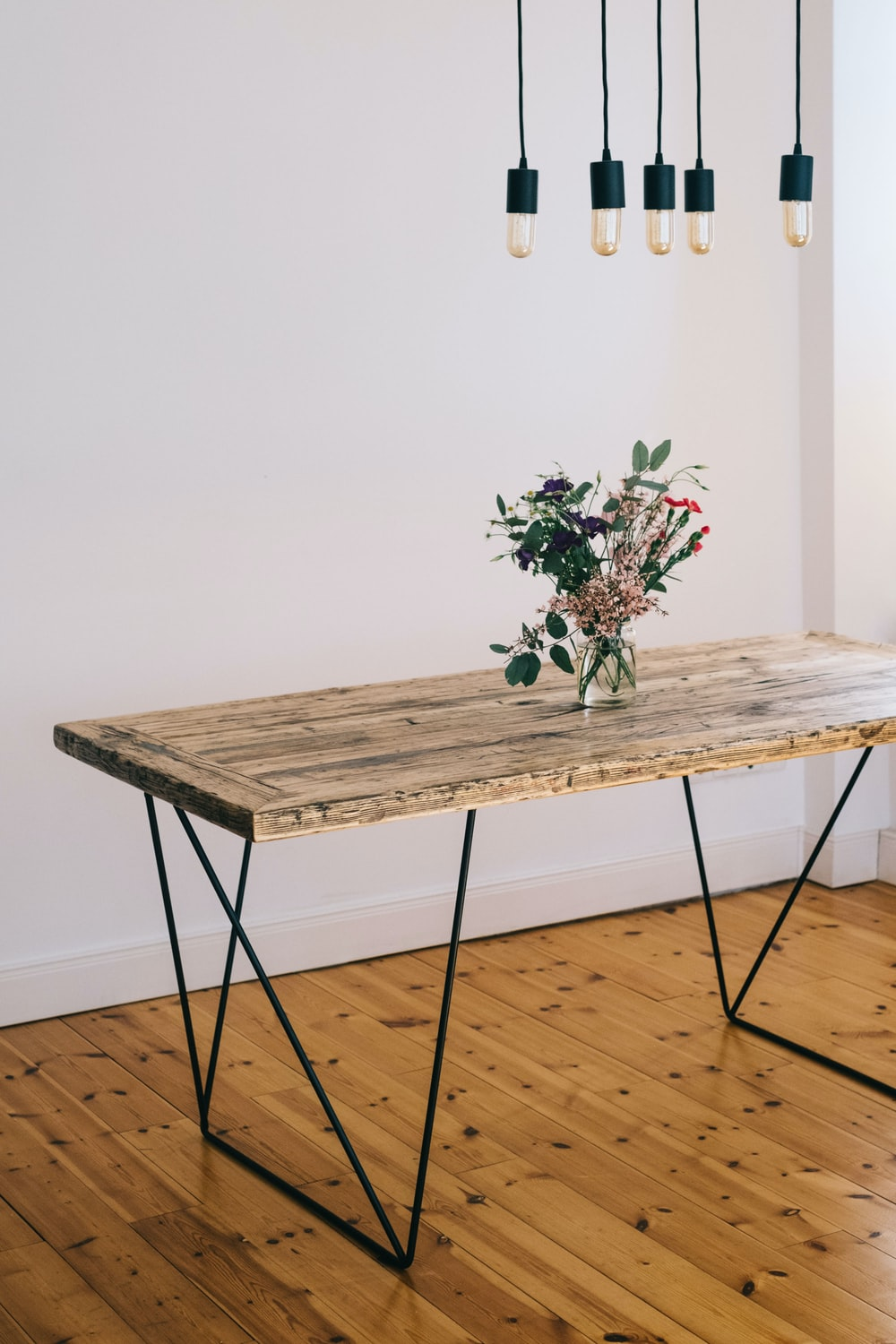 brown wooden table with green plant on top