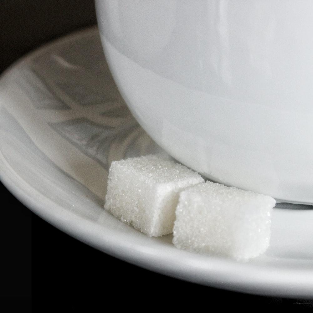 white sugar cube on white ceramic plate