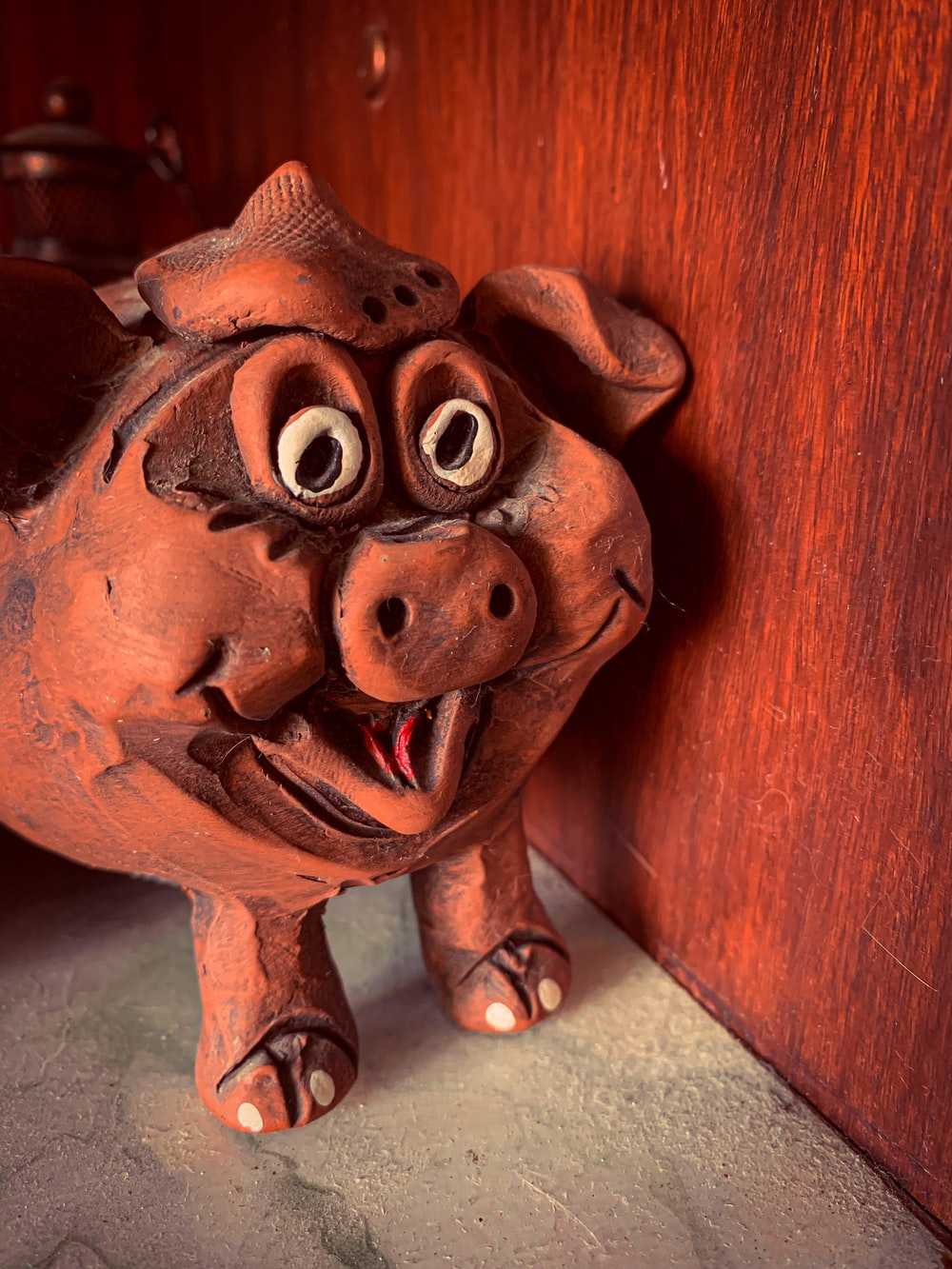 red and black ceramic pig figurine