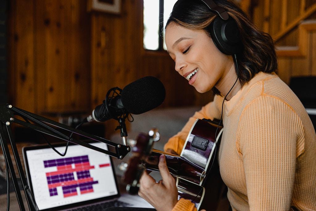 woman in brown sweater wearing headphones