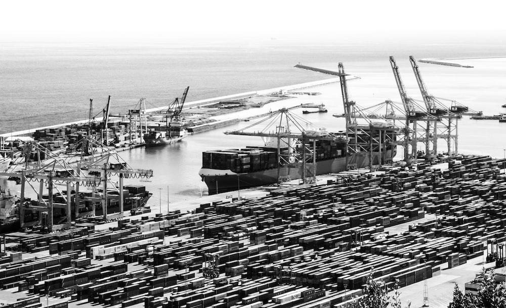 grayscale photo of cargo ship on sea