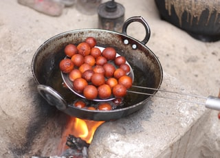 red round fruits in black cooking pan