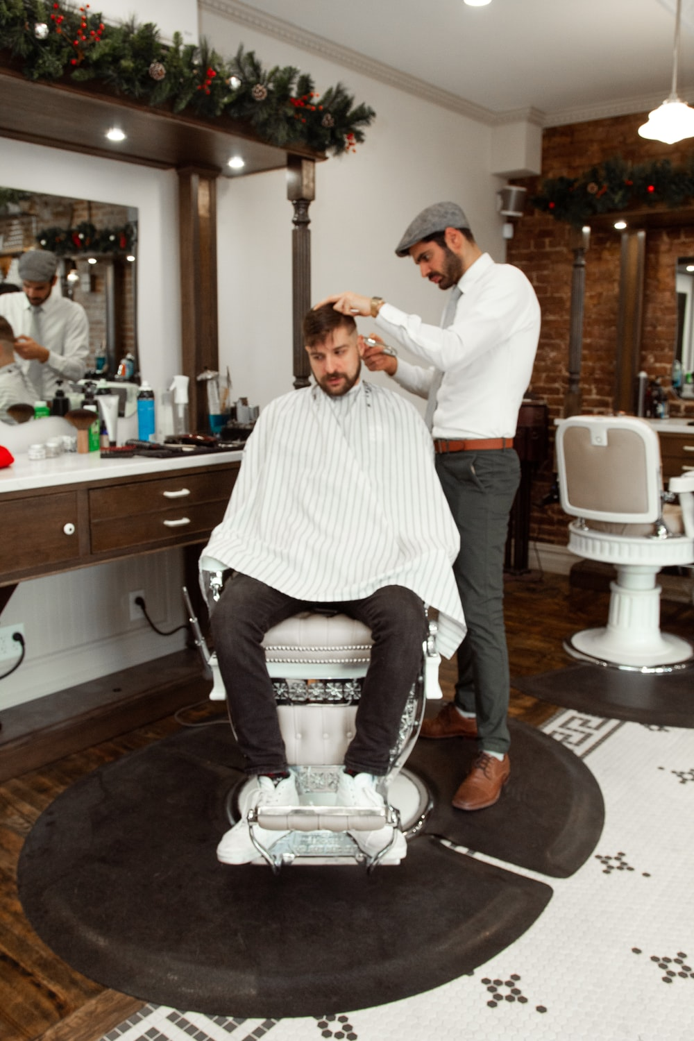 man in white dress shirt sitting on barber chair